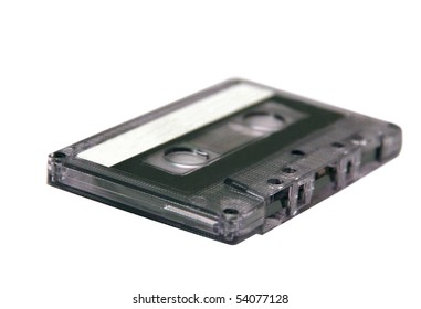 Old music cassette on white background