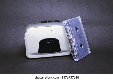 Old music player or cassette player on black back ground with cassette