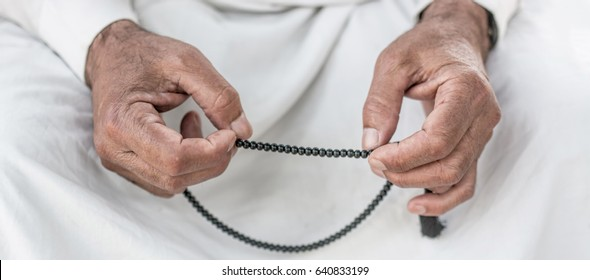 Old muslim Man with rosary praying