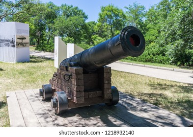 Old muzzle-loading gun. Russia, the Republic of Crimea, the city of Sevastopol. 06/12/2018: Old cast-iron ship cannon in the park on Historical Boulevard
