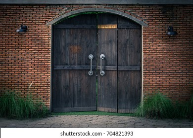 Old and mysterious doors are made of wood, The door handle is a steel rod for pulling and pushing.