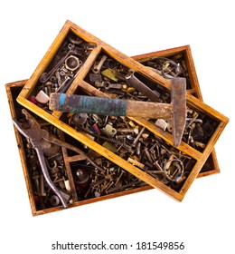 Old nails, screws and plugs in different types and sizes. Tools