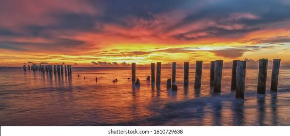 Old Naples Pier, Naples, Florida at sunset. Travel Concept.