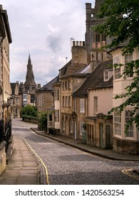 Old narrow cobbled street with stone houses, Barn Hill and All Saints Place, Stamford, Lincolnshire, England, UK