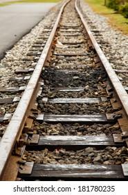 Old narrow gauge railroad tracks into distance