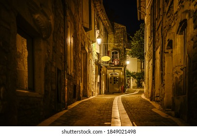 Old narrow paved street in night european town. Narrow paved street. Night narrow pave street view. Paved street at night