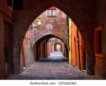 Old narrow street with arch in Ferrara, Italy.  Ferrara is capital of the Province of Ferrara