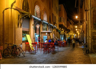 Old narrow street in Bologna, Emilia Romagna, Italy. Night cityscape of Bologna.
