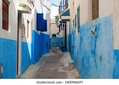 Old, narrow street in the Kasbah of the Udayas with blue and white painted houses. The Kasbah of the Udayas is a major tourist attraction of Rabat. Morocco.