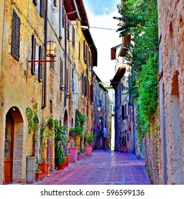Old narrow street in the medieval Tuscan town of San Gimignano, Italy