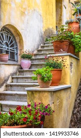 Old narrow street in Plaka district, Athens, Greece. Plaka is a famous tourist attraction of Athens. Vintage steps with flowers. Beautiful stair of cozy alley on Acropolis slope in the Athens center.