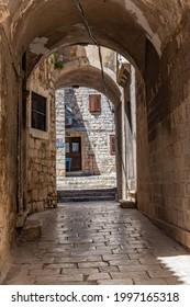 Old narrow street in the old town of Sibenik, Croatia - Shutterstock ID 1997165318