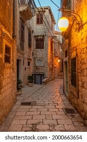 Old narrow street in the old town of Sibenik, Croatia - Shutterstock ID 2000663654