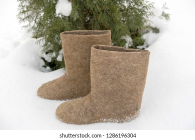 Old national traditional Russian winter footwear is felt boot. Name valenki literally means made by felting.