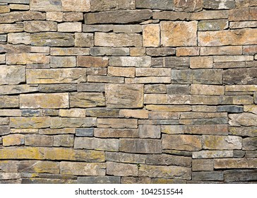 Old natural dry stone wall, rectangles dressed sedimentary rocks