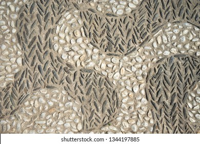 old natural stone pavement background, wall with pebbles stone texture