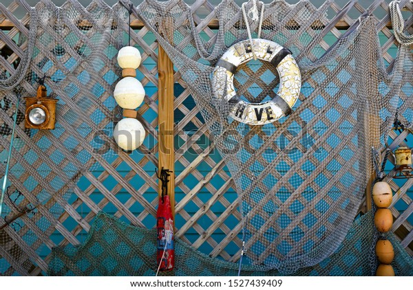 Old Nautical Gear Hanging on a Wood Fence