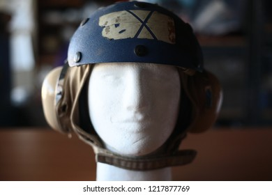 A old Navy soft helmet for aviation crewmen on a display mannequin.