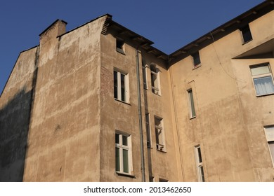 an old, neglected tenement house, a building in Poland, windows, sky, concrete, brick - Shutterstock ID 2013462650