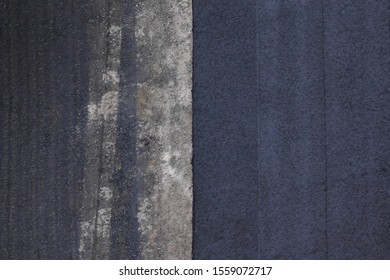 The old and new asphalt road texture. Road works flooring asphalt laying. Top view
