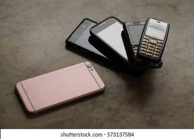 Old and new mobile phones on a marble background