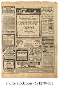 Old newspaper page with vintage advertising. Used paper background