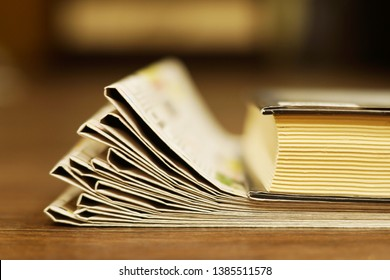 Old Newspapers and Book. Yellow Pages with News and Literature, Concept for Reading