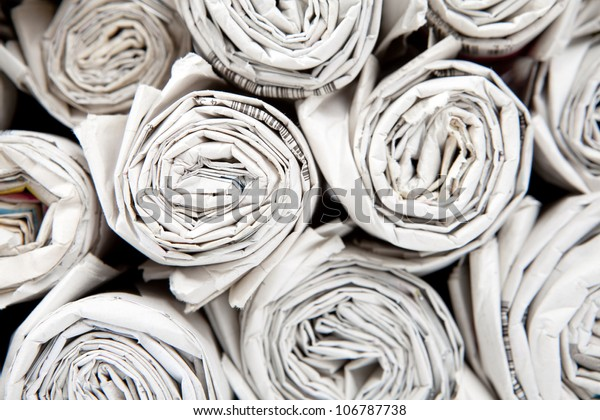 old newspapers rolled into SCROLL