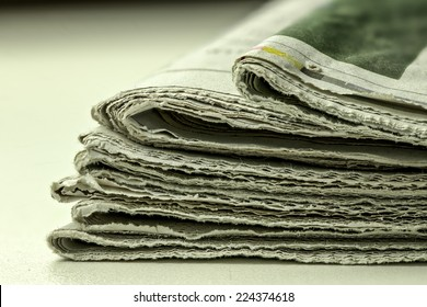 old newspapers stack together, close up shooting