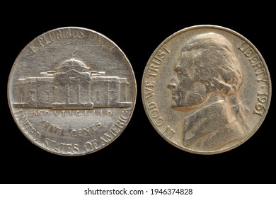 An old nickel coin of 1961, portrait of third president of the United States Thomas Jefferson on obverse and Monticello, Jefferson's home on reverse. Isolated on a black background.