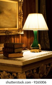 Old night lamp on the table with books