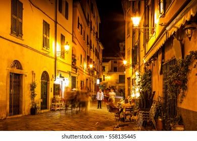 Old night street in Sarzana, Liguria, Italy.