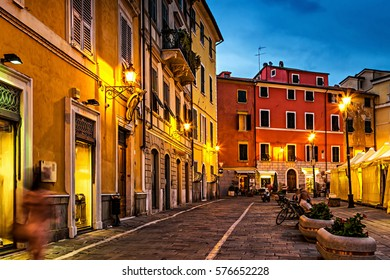 Old night street in Sarzana, Liguria, Italy.
