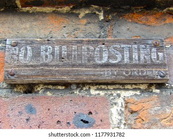 Old No Billposting sign screwed to a brick wall