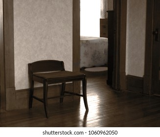 Old Nostalgic Chair in Living Room of Old House with View of Bedroom