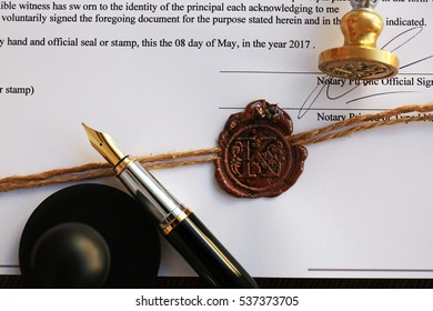 Old notarial wax seal and stamp on document, closeup