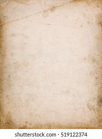 Old notebook cover page with stains, dark borders, dirt and folds