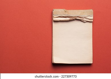 old notebook on red background