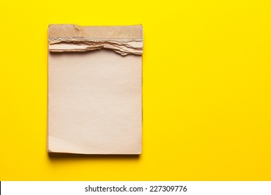 old notebook on yellow background