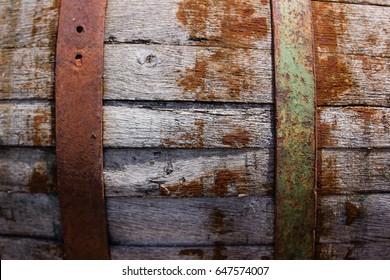 Old oak rusty barrels in cellar