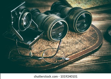 Old objects with lenses: binoculars, camera, magnifying glass and glasses. Vintage style.