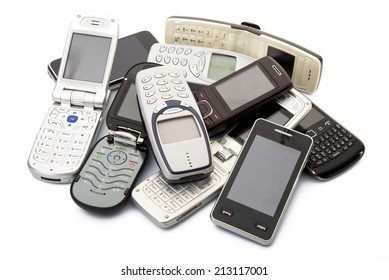 old and obsolete cellphone on white background