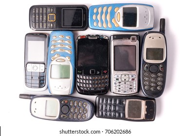 old and obsolete cellphone on a white background.