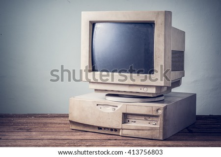 old obsolete computer on old wood stock photo edit now 413756803