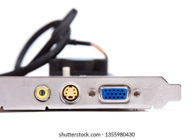 An old obsolete VGA / s-video output graphic card with archaic video outs isolated on white background. Low end pc gaming, old tech and pc components, technological relic of the past abstract concept