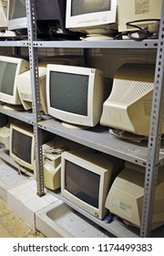 Old office computers stacked and out of use, scheduled obsolescence