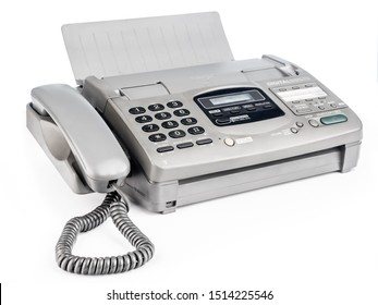 Old office fax machine shot on white background