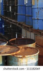 Old oil drums at a dump