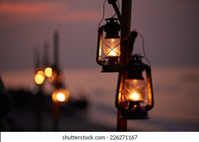 Old oil lanterns on the beach