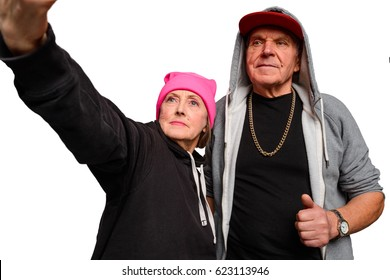 Old ones take a selfie. Couple of crazy old people looks straight to camera. Grandparents don't wanna get old and do the things what young people do.